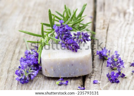 bar of natural soap, lavender flowers and rosemary - stock photo