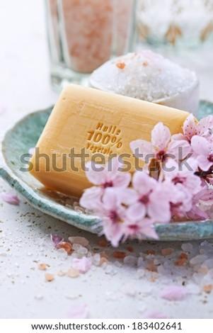 Bar of Natural Soap with Bath Salt - stock photo