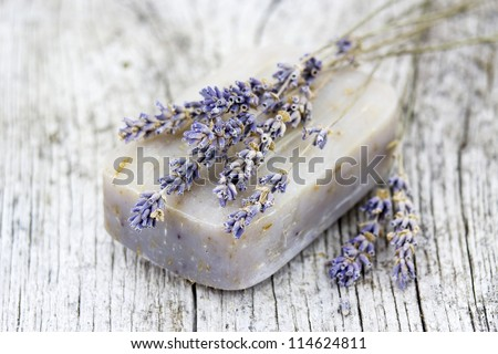 bar of natural soap with dried lavender - stock photo