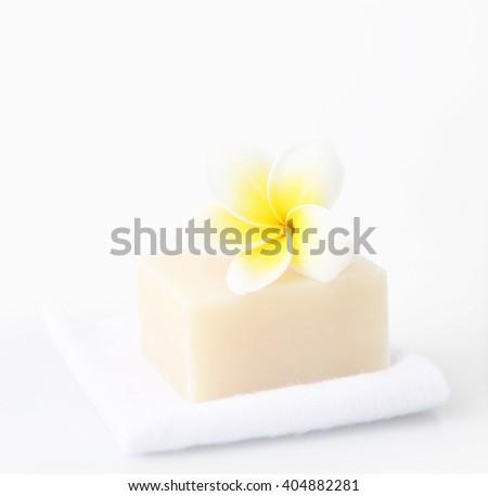 Bar of soap with frangipani flower - stock photo