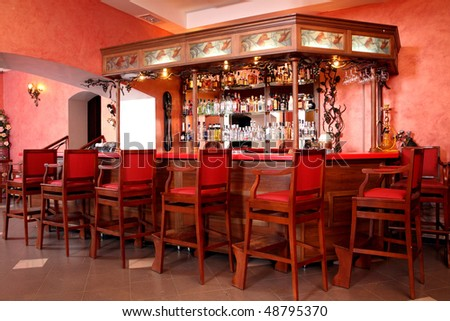 Bar rack with chairs at restaurant - stock photo