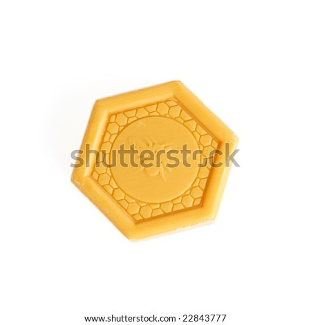 bar soap in a form of a bee hive cell - stock photo