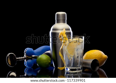 Bar still life with citrus on black background - stock photo