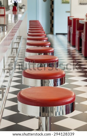 bar stool details in american diner restaurant, shallow DOPF - stock photo