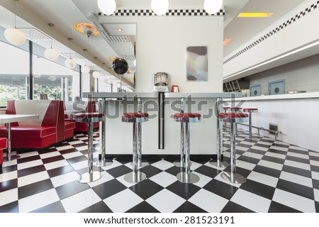 bar stools in a american diner restaurant - stock photo
