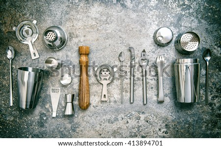 Bar tools for making cocktail. Shaker, jigger, strainer, spoon. Vintage style toned picture - stock photo