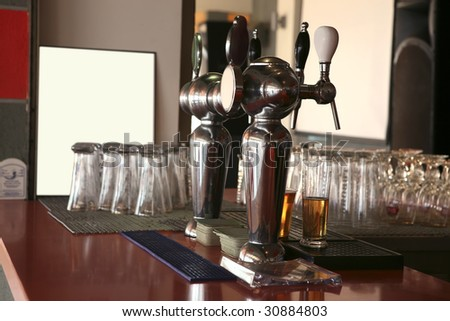 bar with glasses and beer - stock photo
