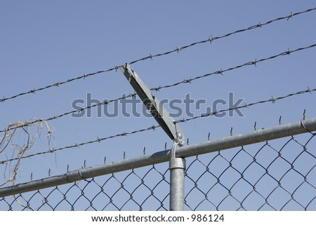 Barb wire fence - stock photo