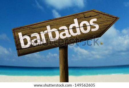 Barbados wooden sign with a beach on background  - stock photo