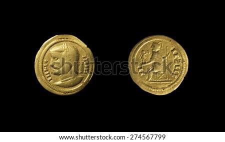 Barbaric Imitation of a gold coin Aureus of the Roman Empire. Claudius Lucius Valerius Domitius Aurelian - stock photo