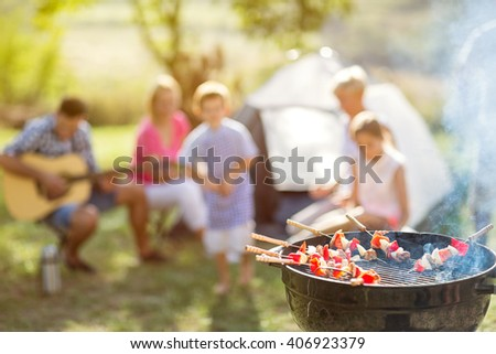 barbecue and family on camping in nature - stock photo