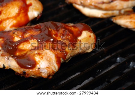 Barbecue chicken breast on a grill