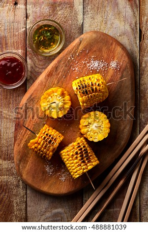 Barbecue Corn on Rustic Wooden Table