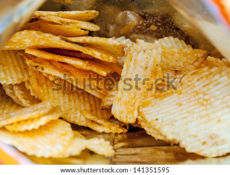 Barbecue flavored of potato chips fried in the bag