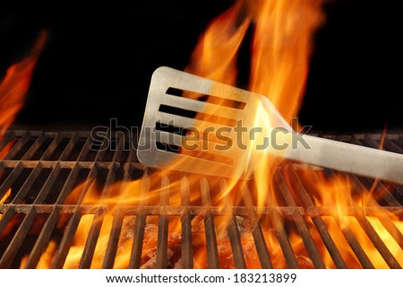 Barbecue Grill Fire Flame Hot Spatula, with space for text or image. - stock photo