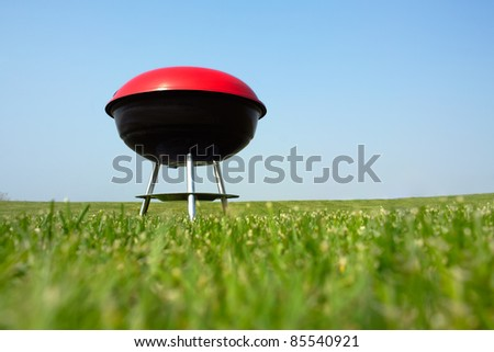 Barbecue grill on green meadow - stock photo