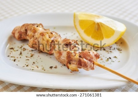 barbecue, grill skewer, pork (or chicken) on wooden grill spits - stock photo