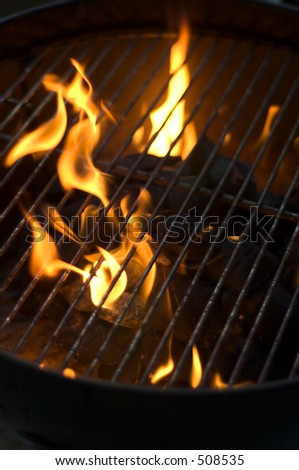 barbecue grill with charcoal in flames - stock photo