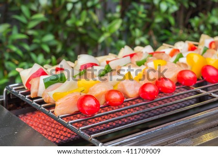 Barbecue grill with various kinds of meat - stock photo