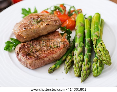 Barbecue Grilled Beef Steak Meat With Asparagus And Tomatoes