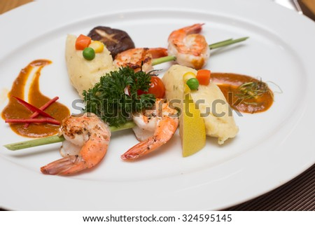 barbecue, grilled shrimp seafood on a white plate