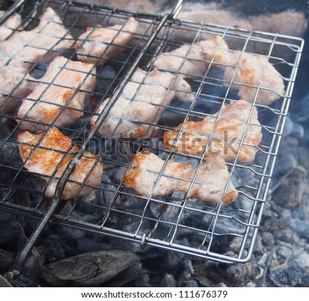 barbecue meat slices prepare on fire