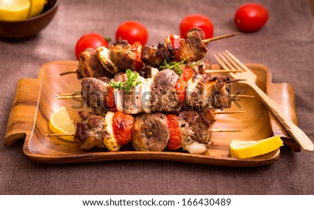 Barbecue meat with vegetables on skewers  - stock photo