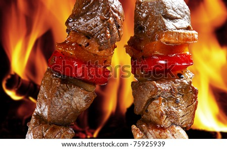 barbecue on flaming hot - stock photo