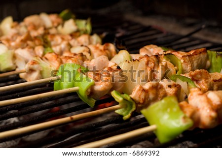 Barbecue on sticks - meat and vegetables frying