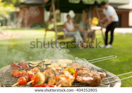Barbecue party - delicious food on the grill - stock photo