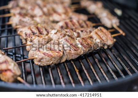 Barbecue photo: grilled meat fried on grill lattice