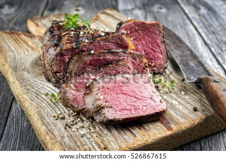 Barbecue Point Steak on old Cutting Board