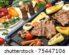 Barbecue, prepared beef meat and different vegetables and mushrooms on grill - stock photo