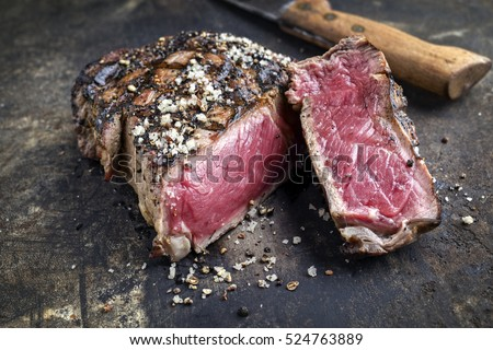 Barbecue Prime Rib Steak on old Metall Sheet