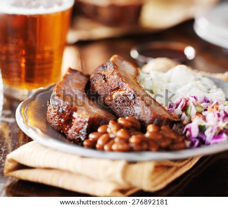 barbecue rib meal with fixings - stock photo
