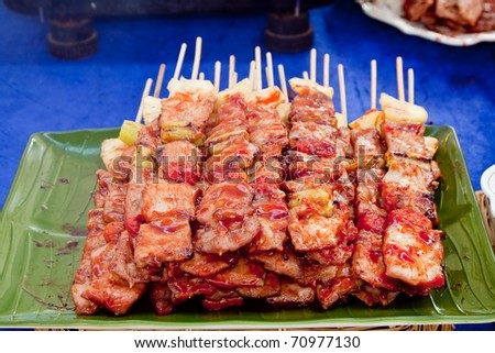 Barbecue's pile ready to be serve in a green dish, Sriracha Thailand - stock photo