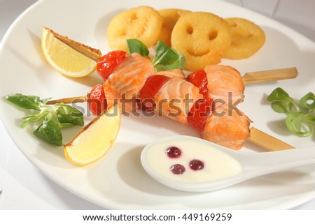 barbecue salmon on a skewer on plate