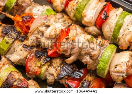 Barbecue Shishkabob With Chicken Meat, Red Peppers, Mushrooms, Tomatoes And Zucchini - stock photo
