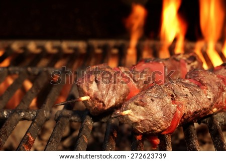 Barbecue Skewered Beef Kebabs With Vegetables On The Flaming Grill Close-up
