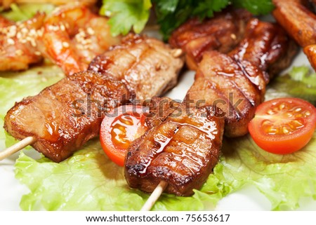 barbecue with sauce and vegetables - stock photo