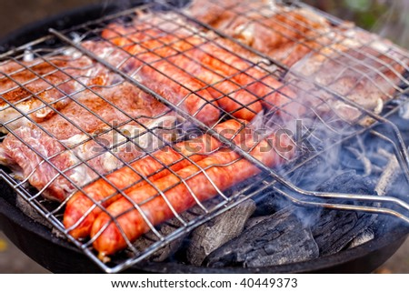Barbecue with sausages and pork steak