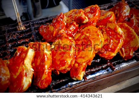 barbecued chops on the grill - stock photo