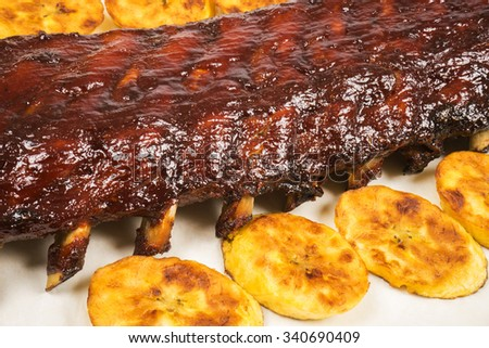 Barbecued Pork Baby Back Rib and Fried Plantains - stock photo