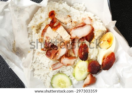 Barbecued red pork in sauce with rice on paper packaging represent the paper packaging for food concept related idea.