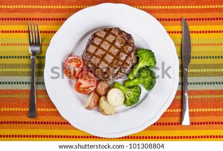 Barbecued Rib Eye Steak Served with Broccoli, Potatoes and Tomatoes