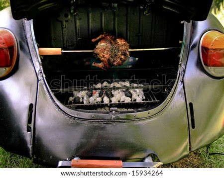 Barbecued rotisserie chicken on the vw grill - stock photo