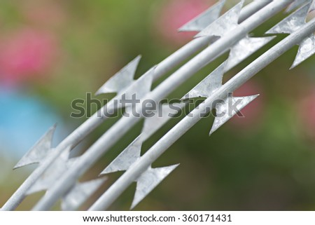 Barbed wire against closeup. - stock photo