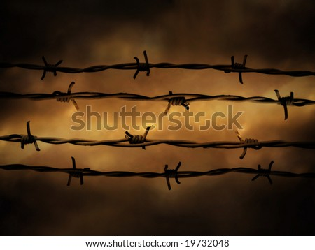 Barbed wire fence against dramatic, dark sky. - stock photo