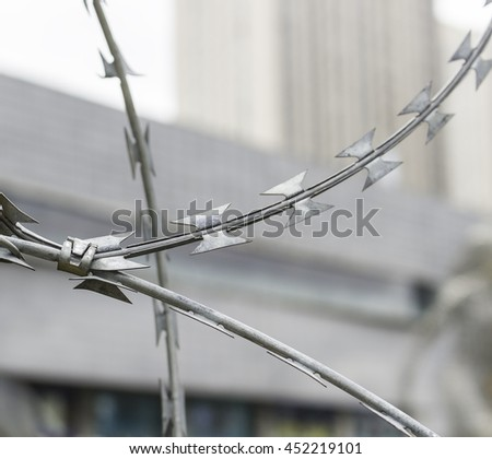 Barbed wire fence of a restricted area Rusty barbed wire attached to a fence. Barbed wire fence The drop after the settled fog reflects the surrounding wood in a branch free Binding Enemies Jesus    - stock photo
