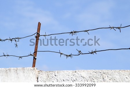 barbed wire fence on the  against the sky
